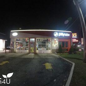 automotive shop holiday light installation by itrim4u