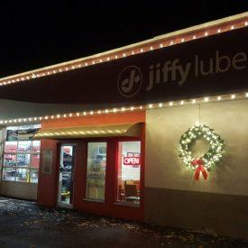 itrim4u holiday lighting setup at jiffylube automotive shop